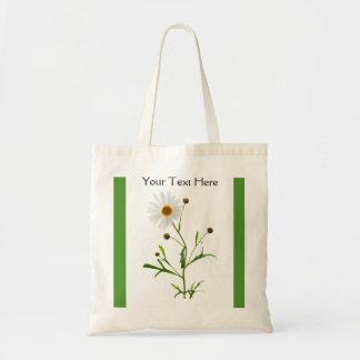 Marguerite douce sur le vert sac de toile