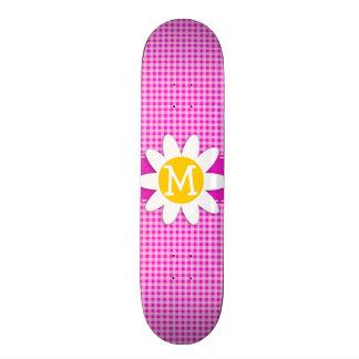 Marguerite mignonne sur le guingan rose magenta ch plateaux de skateboards