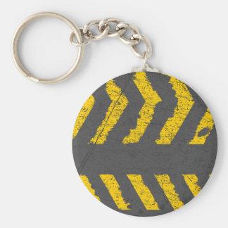 Marquage routier jaune affligé par grunge porte-clé rond