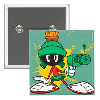 Marvin avec l'arme à feu badge