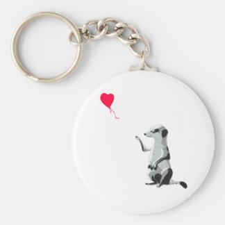 Meerkat et le ballon rouge porte-clé rond