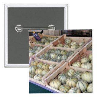 Melons de Charentais montrés dans l'épicerie Badge Avec Épingle