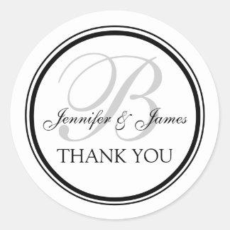 Merci décoré d'un monogramme pour des mariages sticker rond