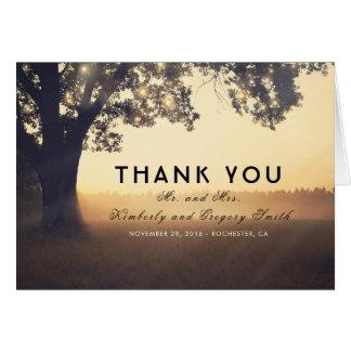 Merci rustique de mariage de lumières d'arbre et cartes