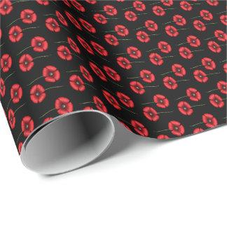 mini pavots rouges sur le papier d'emballage de papier cadeau