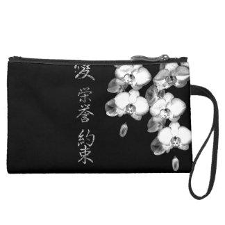 Mini-pochette Simili Daim Orchidées japonaises dans le noir