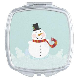 Miroir argenté avec le bonhomme de neige tiré par miroir de poche