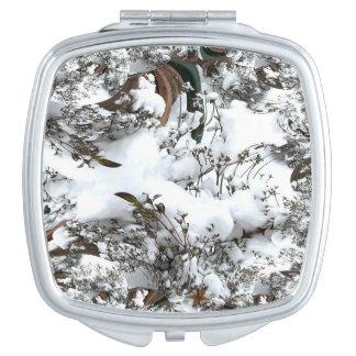 Miroir compact abstrait de neige