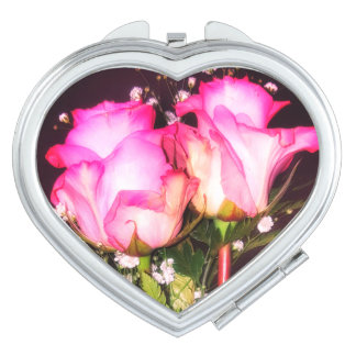 Two pink roses with baby's breath compact mirror