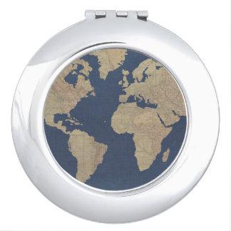 Miroir Compact Or et carte bleue du monde