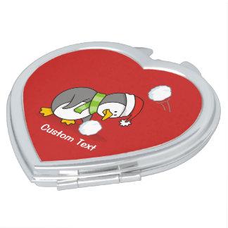 Miroir Compact Pingouin de Noël obtenant une boule de neige
