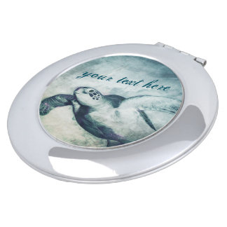 Miroir compact vert volant de la tortue de mer |