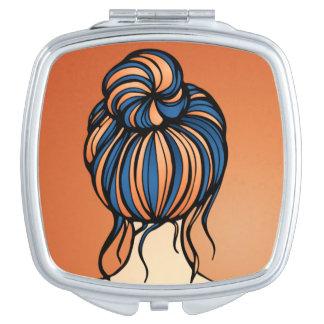Miroirs À Maquillage Miroir bleu et orange de fille auburn de cheveux