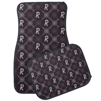 Monogramme abstrait noir de motif tapis de voiture