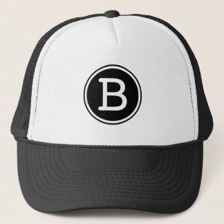 Monogramme blanc de cercle de noir d'anneau casquette