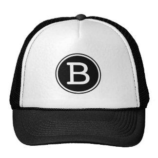 Monogramme blanc de cercle de noir d'anneau casquette trucker
