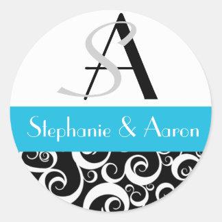 Monogramme de mariage damassé en noir et turquoise