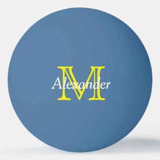 Monogramme jaune et blanc sur le bleu balle tennis de table