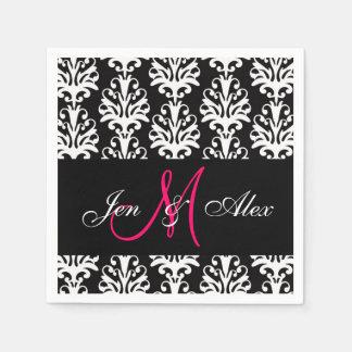 Monogramme noir de rose de damassé épousant les se serviettes en papier