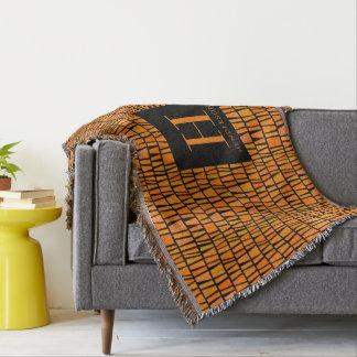 Monogramme orange inspiré africain de motif de couverture