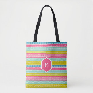 Monogramme sur les points de couture colorés par sac