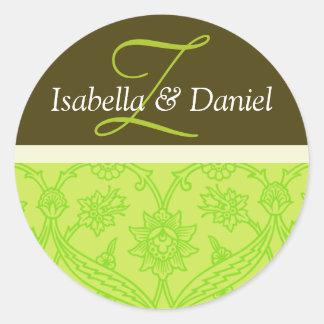 Monogrammes verts de jeunes mariés pour des sticker rond