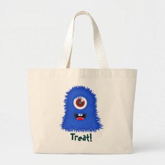 Monstre borgne et bleu, sac de des bonbons ou un