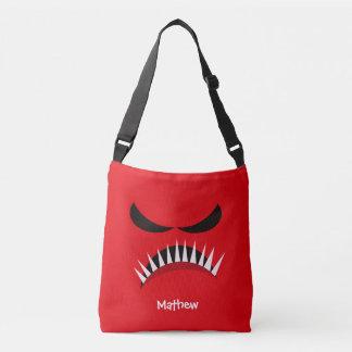 Monstre fâché avec les yeux mauvais et les dents sac