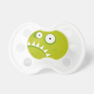 Monstre vert effrayant drôle fâché grincheux tétines