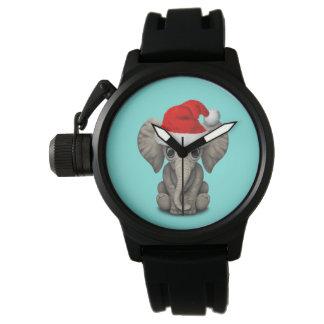 Montre Éléphant de bébé utilisant un casquette de Père