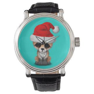 Montre Fox de bébé utilisant un casquette de Père Noël