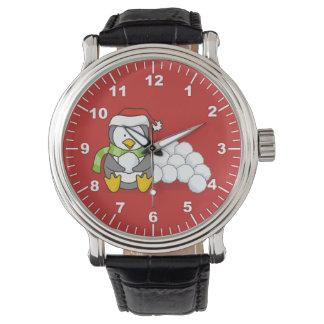 Montres Bracelet Pingouin de Noël se reposant avec des boules de