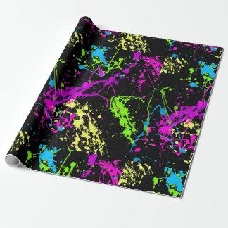 Motif au néon coloré noir d'éclaboussure de papier cadeau noël