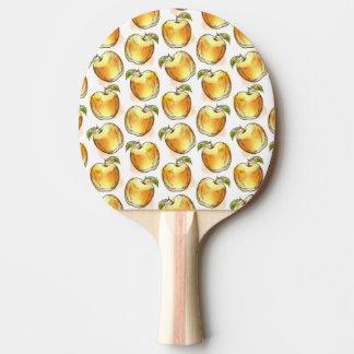 Motif avec la pomme jaune raquette de ping pong