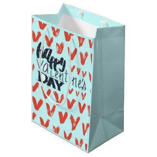 Motif bleu-clair de coeurs de heureuse sac cadeau moyen