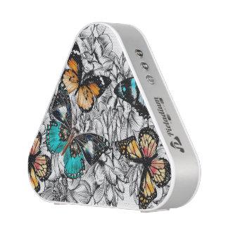 Motif coloré de croquis de papillons floraux haut-parleur bluetooth