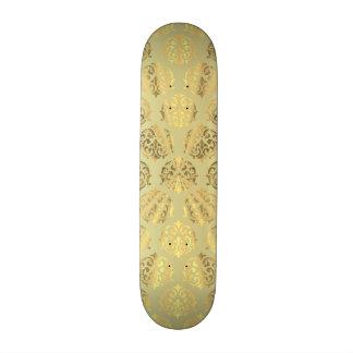 Motif de damassé d'or plateau de planche à roulettes