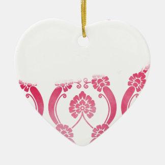 Motif de fleur stylisé dans les roses ornement cœur en céramique