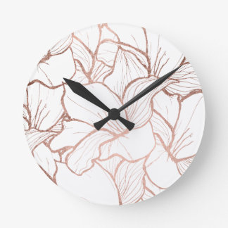 Motif de fleurs rose d'or de faux tiré par la main horloge ronde