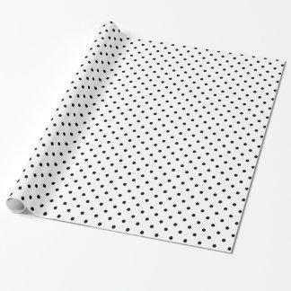 Motif de point noir et blanc de polka papier cadeau noël