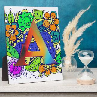 Motif décoré d'un monogramme floral coloré mignon plaque photo