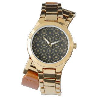 Motif géométrique brillant d'or noir élégant montres