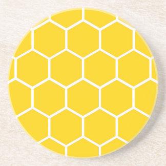 Motif jaune de nid d'abeilles dessous de verres