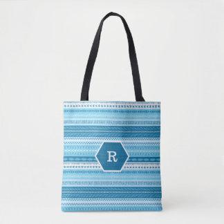 Motif piqué de couture barré par bleu décoré d'un sac