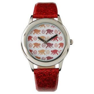 Motif rouge de singes montres