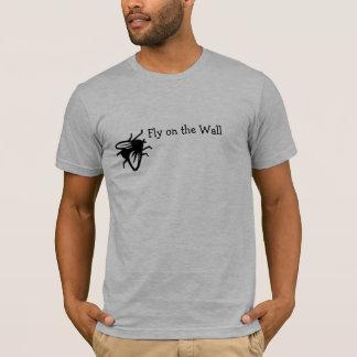Mouche sur le T-shirt de mur