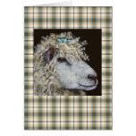 moutons avec la carte de nid sur le plaid