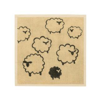 Moutons blancs et noirs sur l'arrière - plan crème impression sur bois