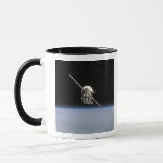 Mug Le vaisseau spatial de Soyuz TMA-11 au-dessus du