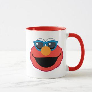 Mug Visage de sourire d'Elmo avec des lunettes de